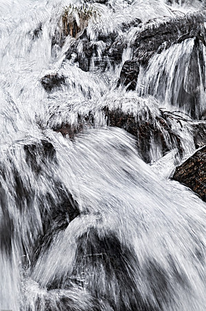 I passed this wild little waterfall on a long springtime hike near Rollins pass. There was still lots of snow on the ground and tons of snowmelt flowing in the river.   Photographically, I reallyI like all the texture. I think it conveys how energetic this part of the waterfall was.